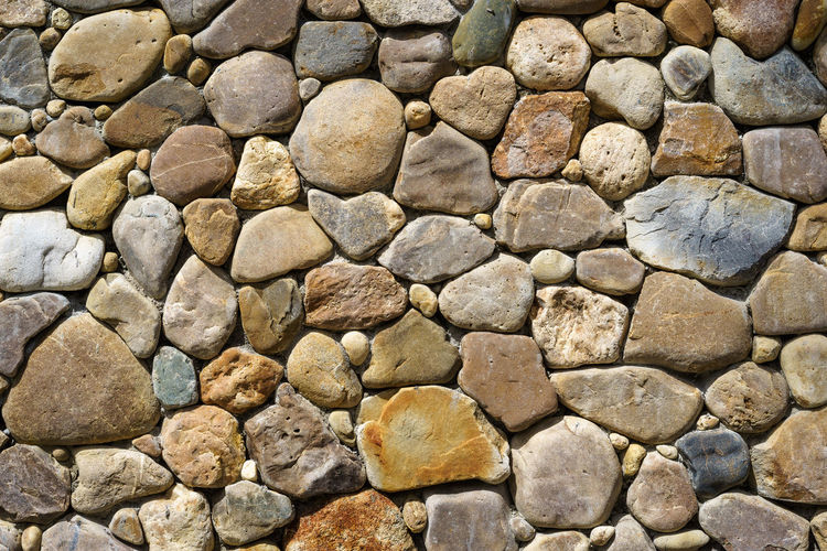 Architecture Backgrounds Built Structure Concrete Day Full Frame Large Group Of Objects Nature No People Outdoors Pattern Pebble Rock Rock - Object Rough Solid Stone - Object Stone Material Stone Wall Textured  Textured Effect Wall Wall - Building Feature