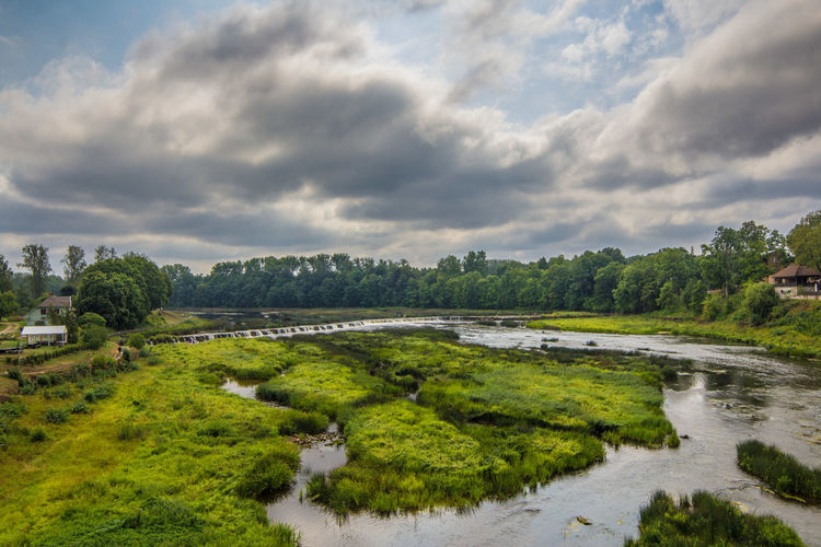 Beauty In Nature Cloud - Sky Day Grass Green Color Growth Landscape Nature No People Outdoors River Scenics Sky Tranquil Scene Tranquility Tree Water