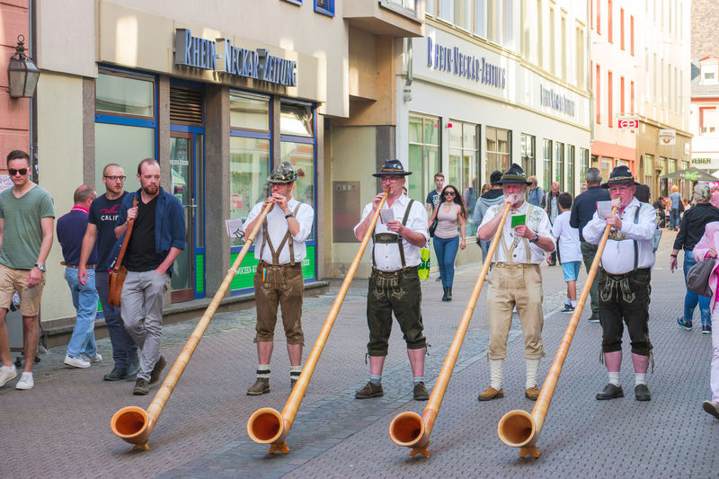 Alphorn player in traditional Bavarian costumes performing on the street of the Heidelberg's old town at the fall folk festival. Alphorn Artist Autumn Heidelberg Germany Labrophone Oktoberfest Performing Traditional Clothing Alphorn Player Alpine Horn Bavarian Clothes Bavarian Clothing City Festival Folklore Full Length Group Of People Leather Trousers Musical Instrument Musician People Playing Real People Street Wooden #urbanana: The Urban Playground EyeEmNewHere