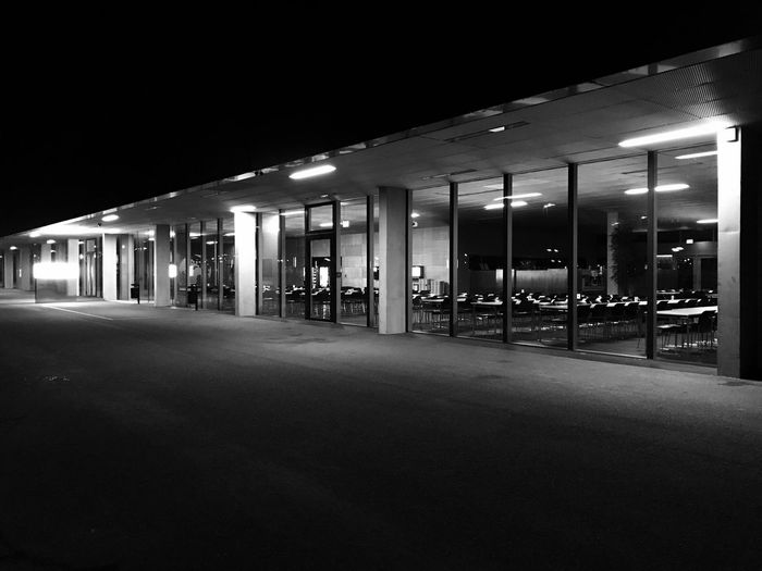 The building has a cool light concept at picture shows the canteen of the University of Applied Science, Neu-Ulm at night near the Wiley Park Iphonephotography IPhone IPhoneography Canteen Wiley Black & White Black And White Blackandwhite Bnw_collection Bnw Light And Shadow Germany Neu-Ulm Hochschule Neu-Ulm University Night Illuminated Built Structure Architecture Building Exterior City Modern
