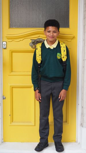 School boy School Boy EyeEm Selects Portrait Full Length Standing Yellow Looking At Camera Smiling Beautiful People Elégance History Front View Yellow Background Front Door