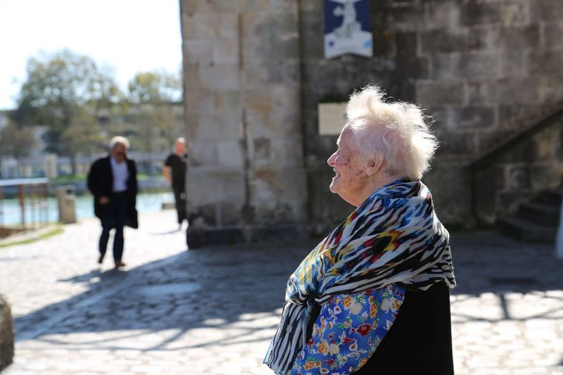 Side view senior woman standing outdoors