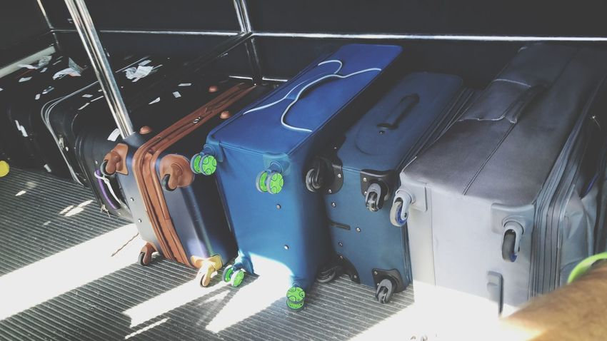 Organized Lines Shadow Heavy Wheels Wheel Vacation Destination Vacation Time Vacation Vacations Trip Photo Trip Bus Luggage Day Transportation High Angle View People Men Nature Indoors  Sunlight Land Vehicle Mode Of Transportation Close-up Motor Vehicle