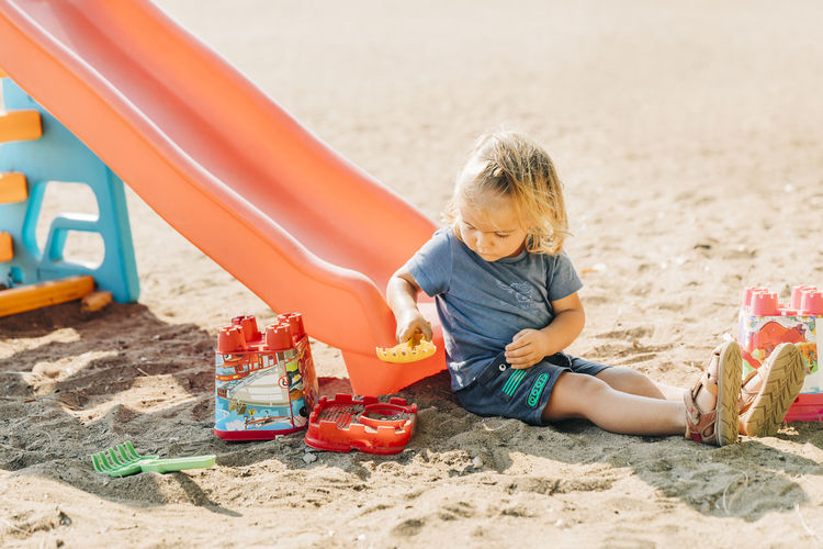 Boy playing with toy on beach
