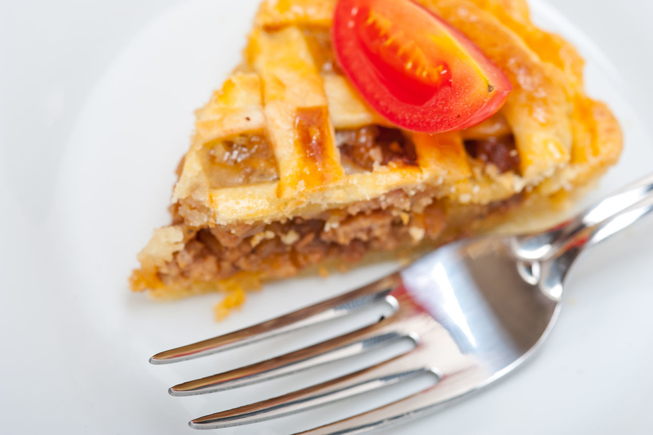 Close-Up Of Pie Slice With Fork On Plate