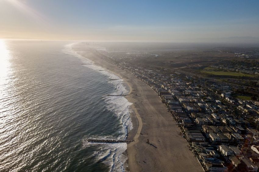 aerial drone view of Balboa Peninsula during sunset in Newport Beach California Newport Beach Orange County, Ca Southern California Vacations Aerial View Architecture Balboa Peninsula Beach Beachphotography Day Drone View High Angle View Homes Land Motion Nature No People Outdoors Pacific Ocean Sea Sunset Travel Destinations Water