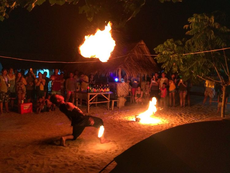 Fireball.. Night Large Group Of People Flame Burning People Arts Culture And Entertainment Adult Men Crowd Celebration Tree Outdoors Illuminated Women Sitting Full Length Audience Firedance Eyeem Philippines Travel Destinations
