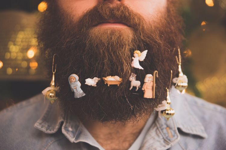 Christmas Ornaments Hanging From Man's Beards