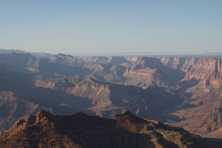 Scenic View Of Rocky Mountains Against Clear Sky At Grand Canyon National Park