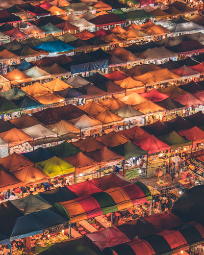 High Angle View Of Colorful Tents At Market During Night