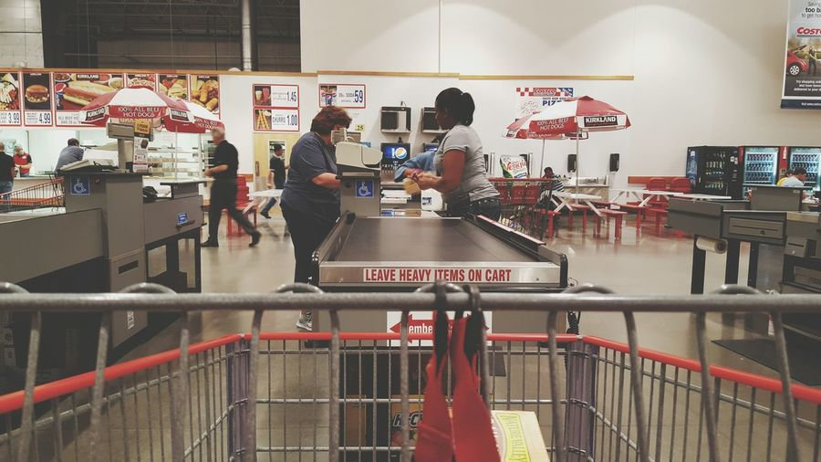 Shopping in Costco. Costco Shopping Cart Grocery Shopping Checking Out Taking Photos People