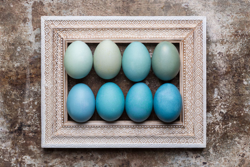 Happy Easter rustic background with copy space. DIY dyed various shades of blue Easter eggs and vintage wooden picture frame mock up. Arts And Crafts Copy Space DIY Easter Easter Egg Easter Ready Easter Eggs Picture Frame Retro Romantic Rustic Backgrounds Blue Directly Above Eggs Flat Lay Greeting Card  Happy Easter Shades Of Blue Spring Springtime Still Life Style Top View Vintage