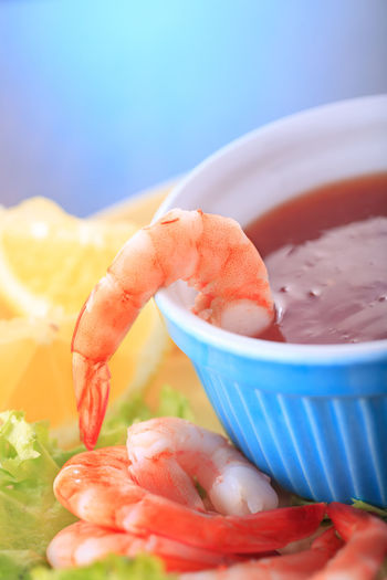 close up shot of a shrimp cocktail Shrimp Shrimp Soup Blue Bowl Close-up Crustacean Day Focus On Foreground Food Food And Drink Freshness Healthy Eating Indoors  No People Prawn Ready-to-eat Sea Food Seafood Selective Focus Shrimp - Seafood Still Life Table Wellbeing