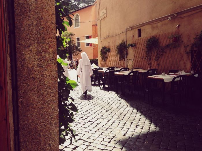 Traveling Sun Light And Shadow Streetphotography Street Photography Nun Sunrise Street Urban Landscape Rome Telling Stories Differently