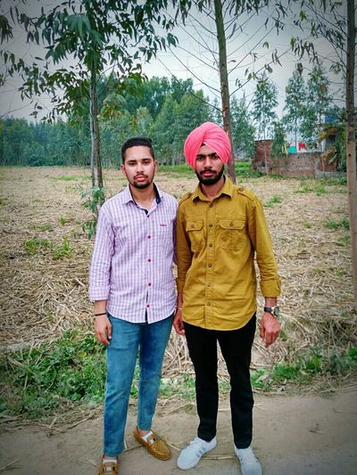 Looking At Camera Full Length Portrait Casual Clothing Two People Mid Adult Men Front View Tree Sweater Togetherness Men Standing Happiness People Adult Real People Adults Only Smiling Only Men Outdoors First Eyeem Photo