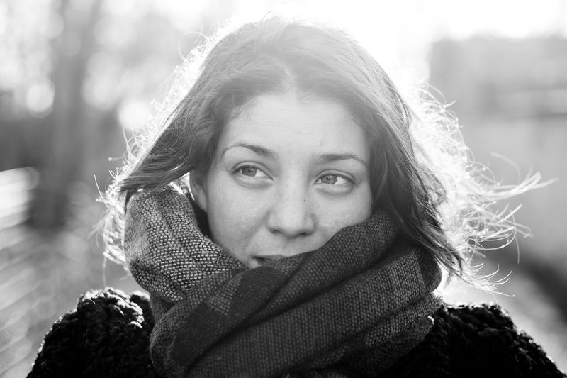 Close-up portrait of woman in winter