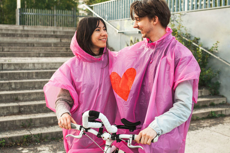 Bond Weather Affection Bycicle Couple - Relationship Couple Outfits Dating Heart Heterosexual Couple Love Outdoors Pink Color Together Togetherness Two People