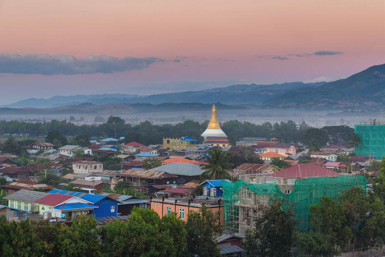 Nyaung Shwe, Myanmar Architecture Building Exterior Built Structure Mountain Building Sunset Sky City Tree Residential District Cityscape Outdoors High Angle View Spirituality Place Of Worship Cloud - Sky Nature Belief Myanmar Burma Nyaungshwe Inle Lake Lake Tourism Travel Destinations