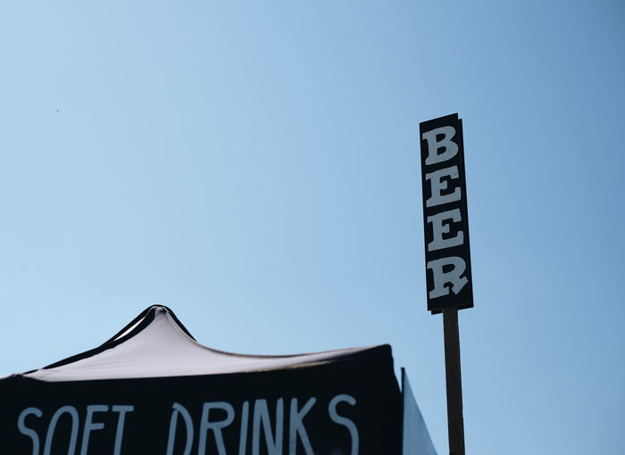 Summer! Beer Refreshment Architecture Blue Communication Day Drink Information Sign Outdoors Sign Text Western Script