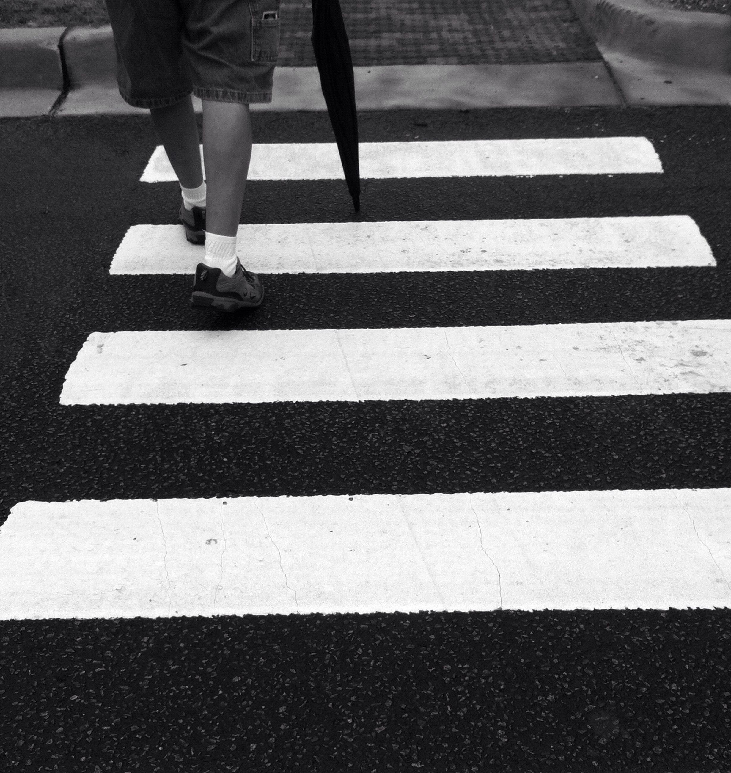 road marking, street, road, low section, transportation, zebra crossing, walking, men, lifestyles, asphalt, person, standing, crossing, crosswalk, leisure activity, day
