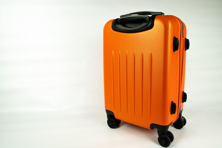 orange modern suitcase Orange Color Single Object Close-up White Background Still Life Copy Space Suitcase Orange Transportation Indoors  Studio Shot No People Modern Modern Suitcas Vacation Vacation Time Trip City Trip Plastic Focus On Foreground Trolley