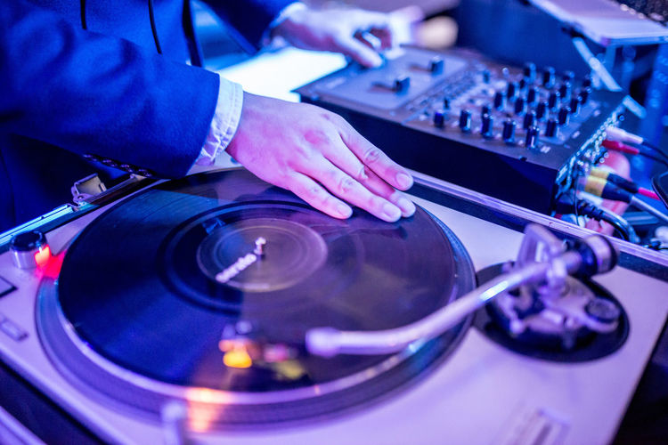 Close-Up Of Person Playing Records