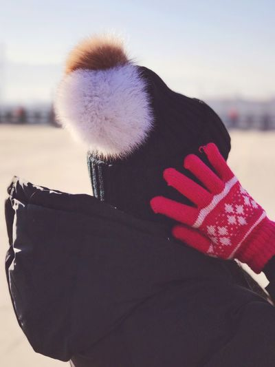 Real People One Person Warm Clothing Lifestyles Focus On Foreground Leisure Activity Winter Close-up Day Snow Outdoors Human Hand Childhood Human Body Part Nature Sky Mammal People