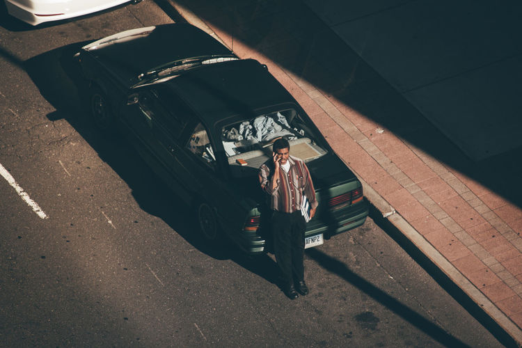 High angle view of woman standing in car