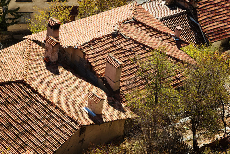 Tiled Rooftops Baked Clay Chimneys Day Outdoors Rectangle Shape Rectangular Red Tile Roofs Rooftop Rooftop View  Stacked Sunlight Tiles
