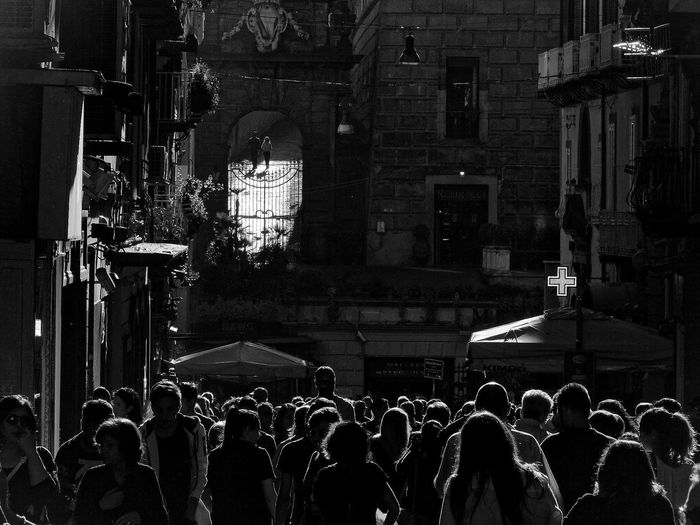 Crowd at illuminated temple at night
