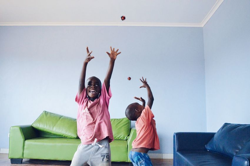 Enjoy The New Normal Arms Raised Playing Throwing  Jumping Excitement Happiness Indoors  Cheerful Togetherness Friendship Childhood Young And Free Orphan Mozambique EyeEm Diversity