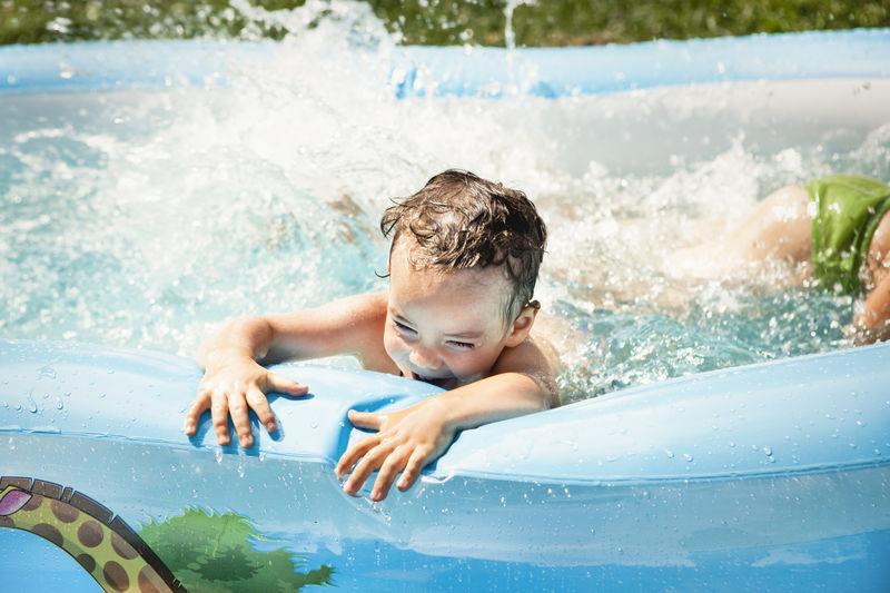 Boy enjoying in swimming pool