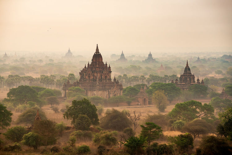 Scenic view of temples in mist