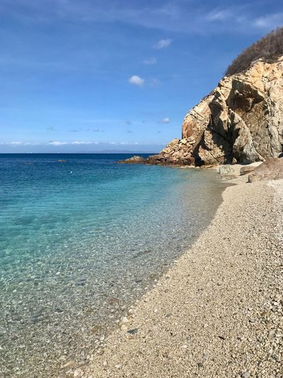 Sea Water Beauty In Nature Sky Beach Scenics - Nature Tranquility Tranquil Scene Land Rock Nature Rock - Object Solid Day Blue Horizon Over Water No People Sunlight Horizon Outdoors
