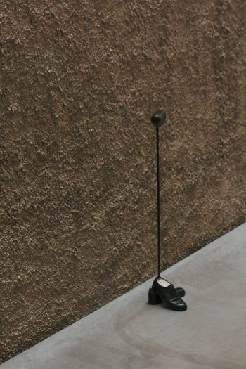 Close-up of electric lamp on wall