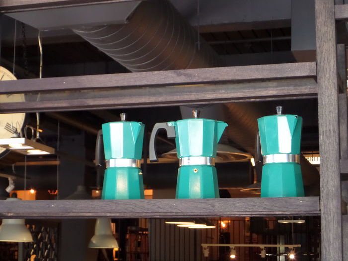 Architecture Arrangement Blue Colour. Built Structure Cafe Culture. Cafe Interior Coffee Pots. Collection Day Decoration Group Of Objects In A Row... Interior No People Shelf Three Blue Coffee Pots In A Row On A Shelf. Three Coffee Pots Three, Variation