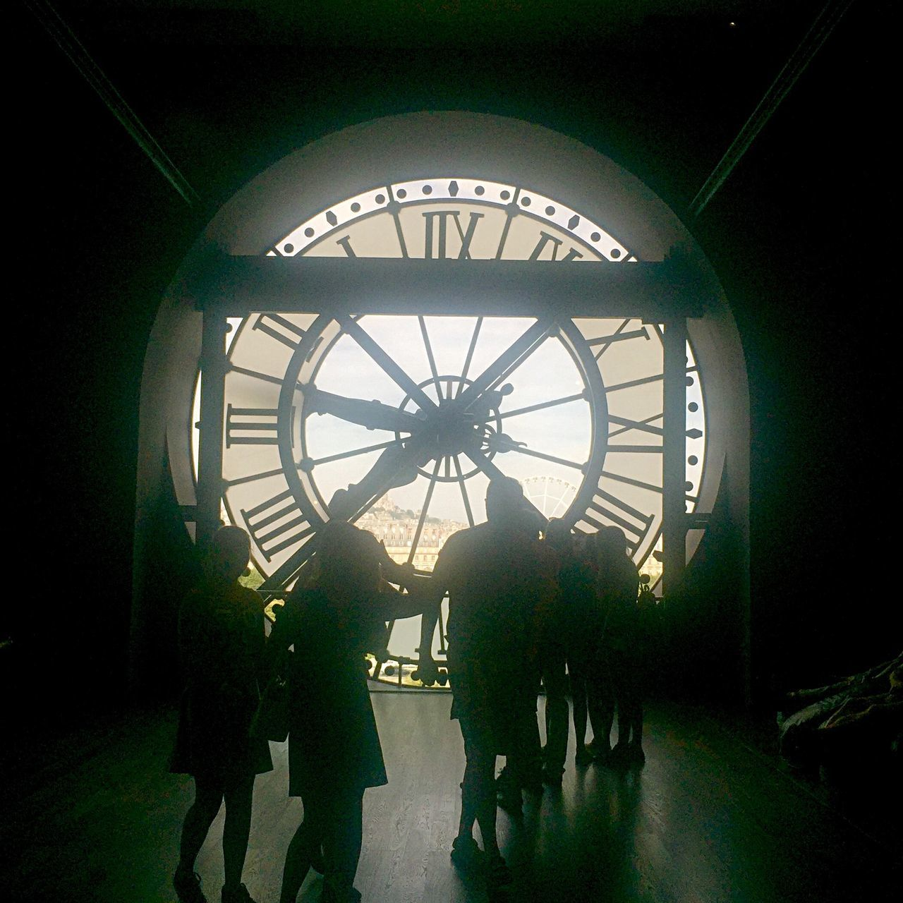 clock, time, real people, indoors, roman numeral, men, silhouette, architecture, day, women, built structure, lifestyles, clock face, large group of people, full length, standing, minute hand, clock tower, group of people, hour hand, people