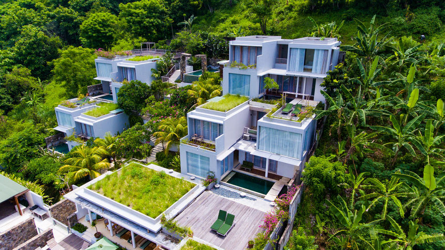 Svarga resort on the island of Lombok. Building Exterior Built Structure Building Architecture Tree Residential District Plant House High Angle View Green Color Nature Day Outdoors No People Home Ownership City Roof Villa Water Luxury Apartment Forest Hotel Hotel View Aerial View