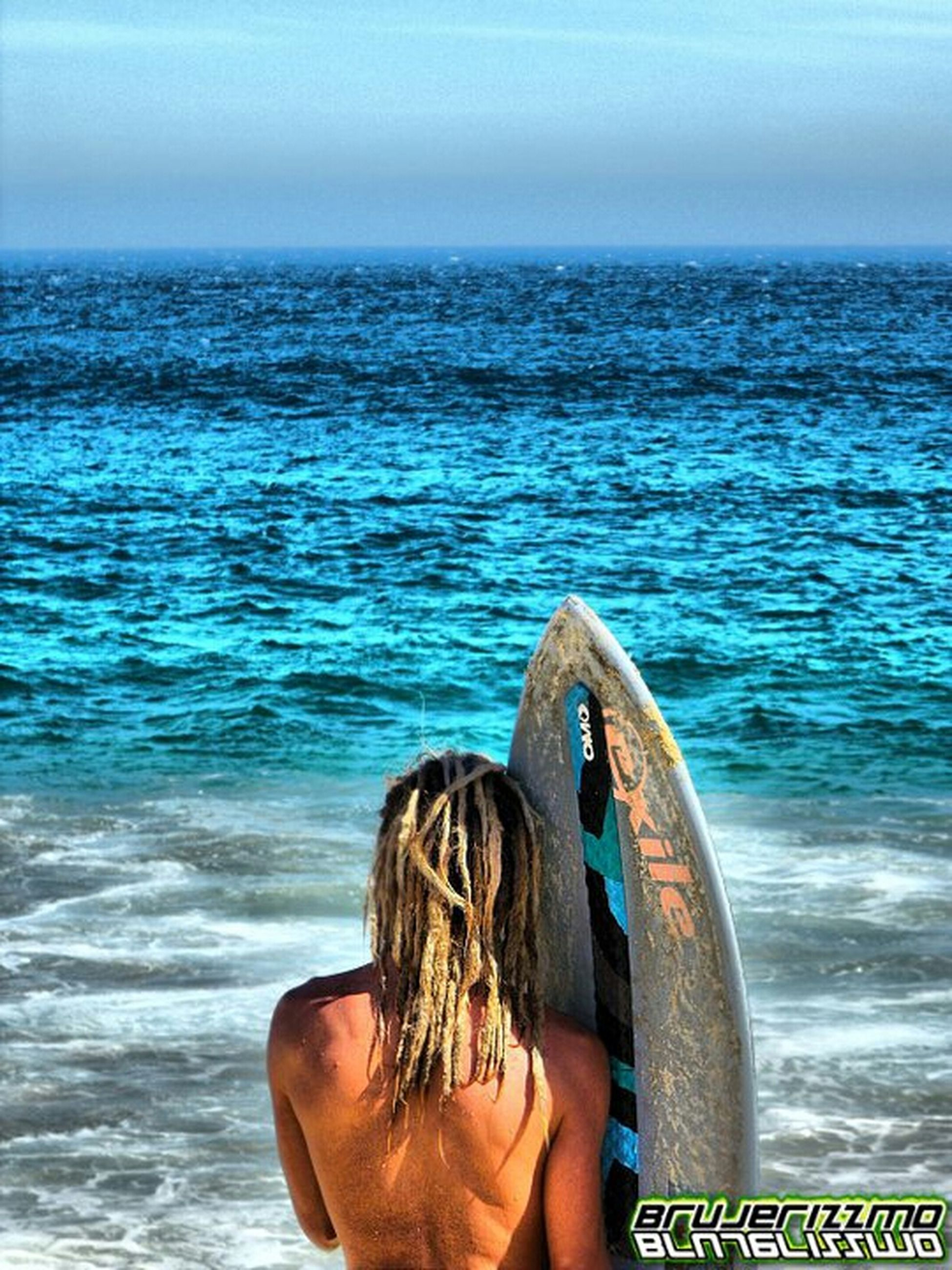 sea, water, lifestyles, leisure activity, horizon over water, rear view, blue, sky, rippled, vacations, nautical vessel, person, scenics, men, nature, waist up, beauty in nature, tranquil scene