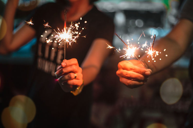 Sparkler Burning Glowing Human Hand Firework Holding Celebration Hand Motion Event Illuminated Night Sparks Human Body Part Focus On Foreground Real People Close-up Firework - Man Made Object Adult Men Firework Display New Year