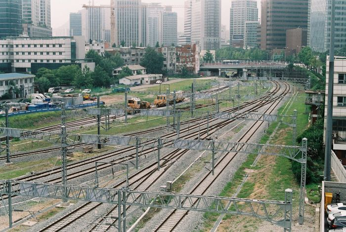 Architecture Building Exterior Built Structure City City Life Cityscape Day Film Film Photography Fm2 High Angle View Modern Nikon No People Outdoors Public Transportation Rail Transportation Railroad Track Skyscraper Train - Vehicle Transportation Travel Destinations Tree Urban Skyline 서울로