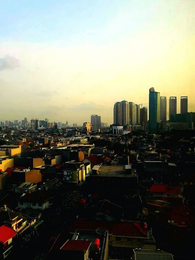 A part of jakarta city 😆 Sky City Cityscape Beauty Beauty In Nature Architecture Outdoors Urban Skyline Cloud - Sky Landscape Horizon Travel Destinations Sunset Day Business Finance And Industry Rear View EyeEmNewHere
