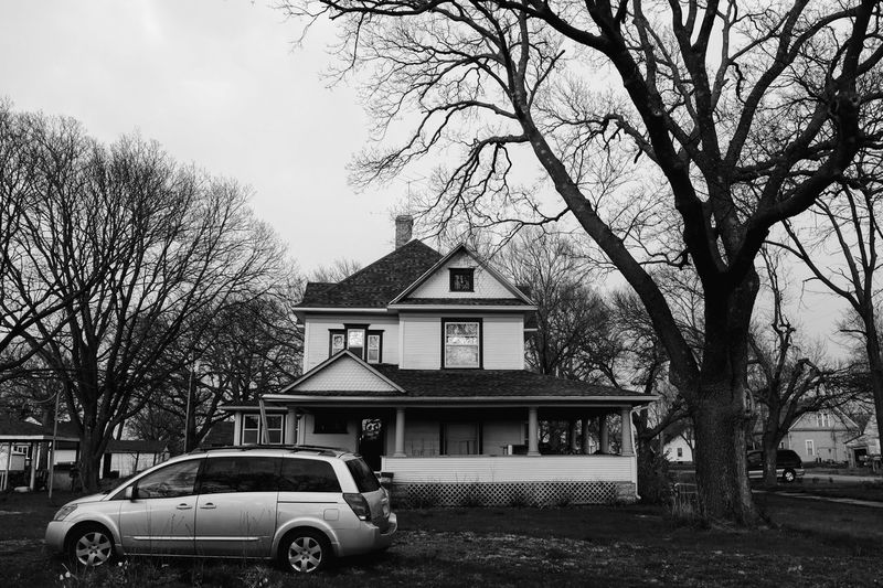 Visual Journal April 14, 2018 Village of Western, Nebraska A Day In The Life Architecture Camera Work EyeEm Best Shots George F. Sawyer House 1916 Getty Images Historical Building Home Sweet Home Photo Essay Rural America Visual Journal Always Taking Photos Architecture B&w Photography Bare Tree Branch Building Building Exterior Built Structure Car Day Eye For Photography Fujifilm_xseries House Land Vehicle Mode Of Transportation Monochrome Motor Vehicle My Neighborhood Nature No People Outdoors Photo Diary Plant Residential District S.ramos April 2018 Schwarzweiß Sky Small Town Stories Transportation Tree