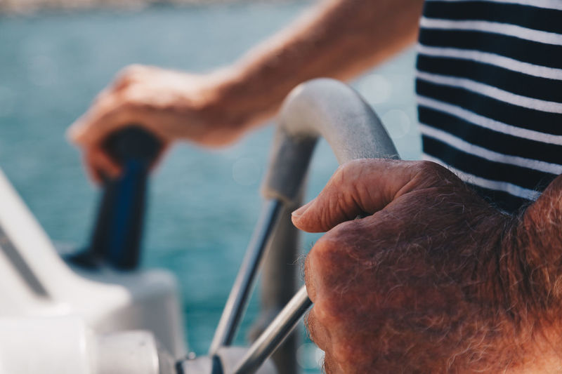 Day Finger Focus On Foreground Hand Holding Human Body Part Human Hand Men Midsection Mode Of Transportation Nautical Vessel One Person Outdoors Real People Sailing Sea Transportation Travel Water Yacht