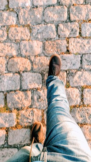 Ande por caminhos retos! - Brick Wall Human Leg Low Section One Person Shoe Personal Perspective Human Body Part Outdoors Day Real People Standing Lifestyles Adult Men One Man Only People Adults Only Close-up Only Men Live For The Story Place Of Heart Out Of The Box The Street Photographer - 2017 EyeEm Awards The Great Outdoors - 2017 EyeEm Awards The Architect - 2017 EyeEm Awards The Photojournalist - 2017 EyeEm Awards The Portraitist - 2017 EyeEm Awards EyeEmNewHere