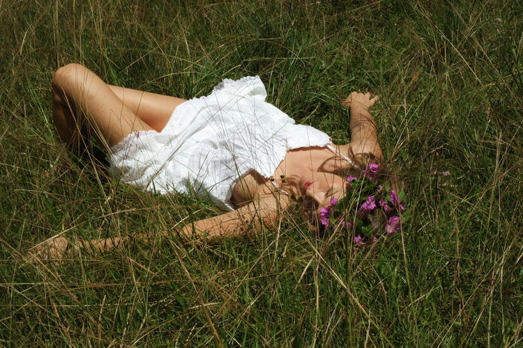 High angle view of woman resting on field