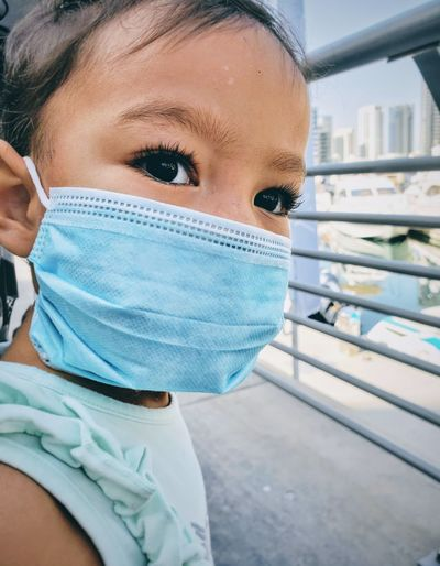 Close-up of girl wearing mask