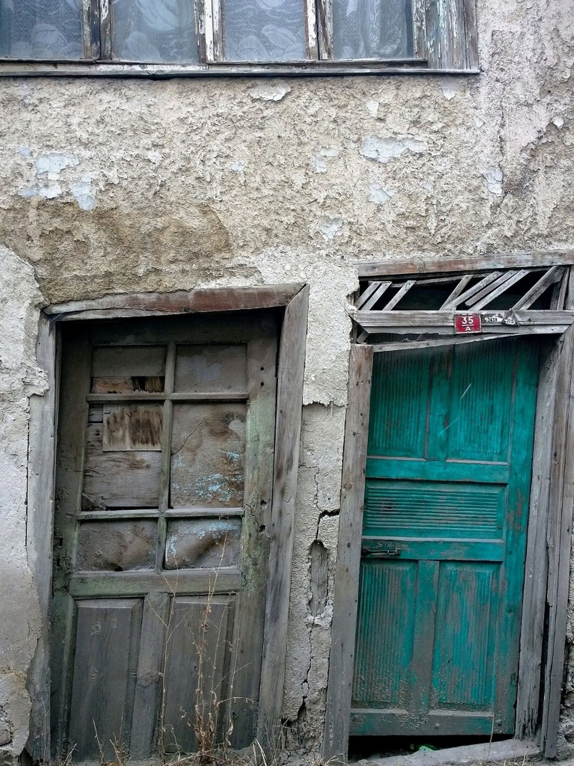 window, building exterior, built structure, architecture, house, door, closed, old, weathered, wood - material, abandoned, damaged, residential structure, day, outdoors, blue, obsolete, no people, protection, residential building