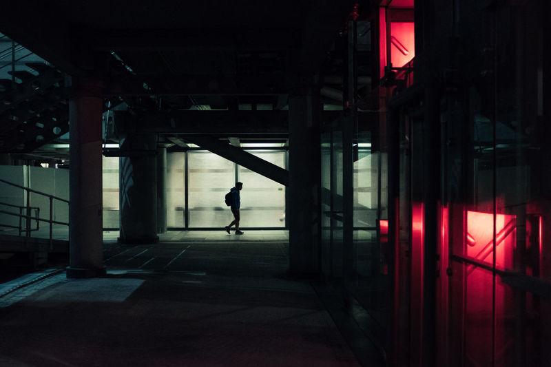 Man walking in illuminated building