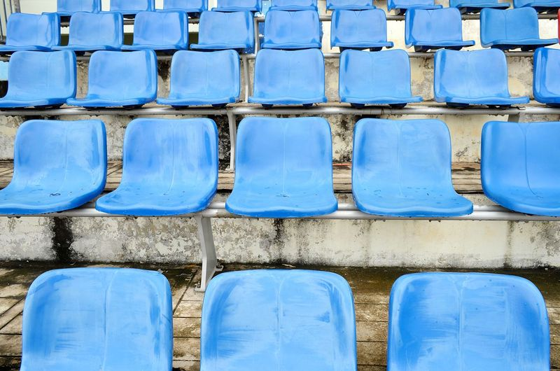 Full frame shot of empty blue seats in stadium